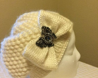 Winter Hat with butterfly pin. Creme