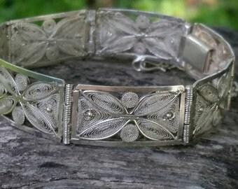 Vintage sterling silver filigree rectangular ladies link bracelet.