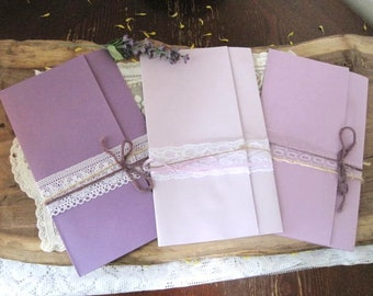 Lace Wedding Invitations: handmade with a lot of variability in color, wrapping, and lace!