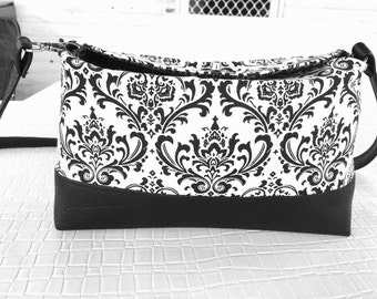 Large day/evening clutch with a detachable shoulder strap