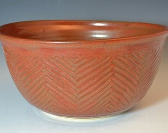 Herringbone carved stoneware bowl iron red