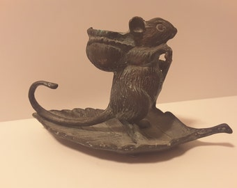 Mouse on a leaf with a candle holder on his back, metal, patina