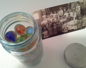 Vintage pharmacy bottle with marbles