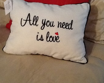 """Embroidered """"All you need is love"""" Pillow"""