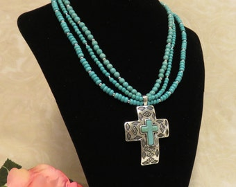 SALE !!! Three Strand Turquoise Necklace w/ Embossed Cross Within A Cross Silver Pendant.