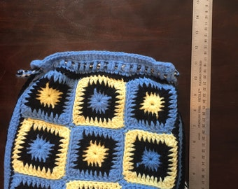 Crochet bag with pockets and drawstring