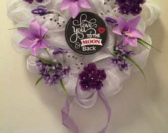 White heart deco meah wreath with a variety of purple flowers