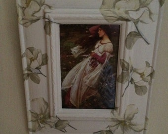 Wooden photo frame decoarated with decoupage flowers