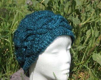 Emerald hat with cables knitted hand