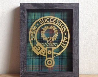 Framed clan crest with tartan backing