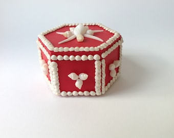 Small red shelled octagonal box