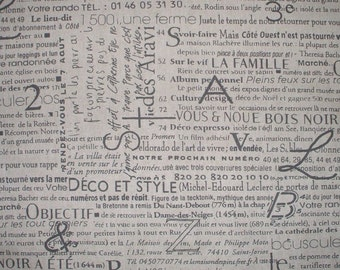 Gray French Script on Beige Linen-Textured Fabric