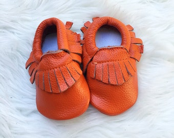Orange moccasins