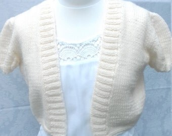 Hand knitted bolero in off white acrylic