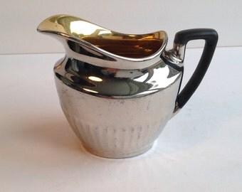 Devonware silverine Georgian style jug