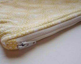 Yellow floral/modern print zip pouch.