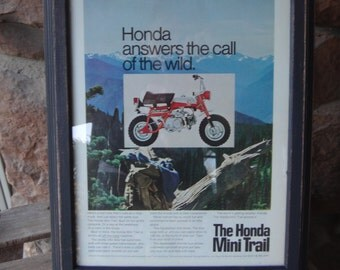 Framed Honda Mini Trail advertisement.