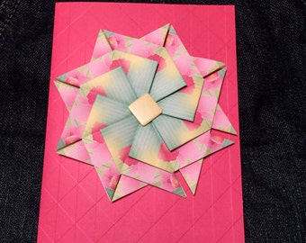 Bright pink paper folded flower