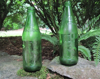 Vintage green glass 7up soda bottles, 10 ounces, lot of 2