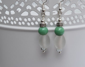 Green and frosted white beaded earrings