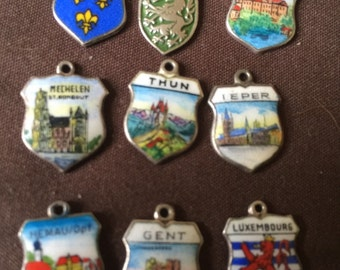 Nine vintage Enamel Travel Charms
