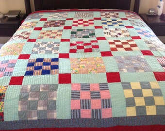 Charming checkerboard queen sized quilt