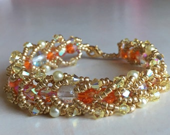 Orange and clear fire polished glass bead spiral rope bracelet