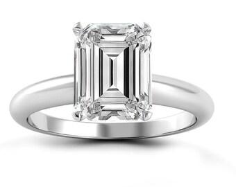 14 k gold ring Diamond Emerald cut 0.55 CT