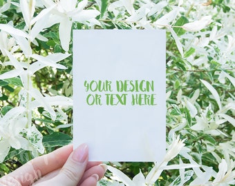 White card in Women Hand on the Background of White Flowers #2 / Product Mockup / High Res File + PSD Smart Object function