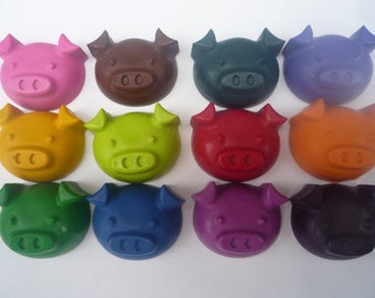 10 pig faced novelty wax crayons