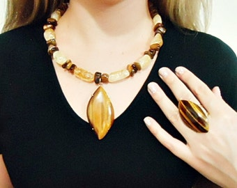 Necklace wtih tiger eye stone and citrines in a set  with ring and earring.