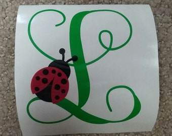 One initial with lady bug