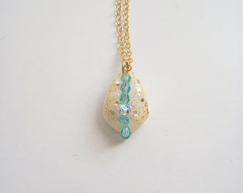 Sea shell shine of gold and 14 swarovski crystal necklace k