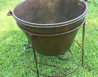 Antique copper pot with stand