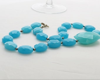Sky blue glass bead necklace with turquoise focus bead