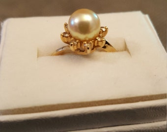 14k pearl and diamond ring. Limited to Aug 30th