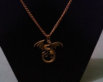 Flying dragon pendant on a brass chain.