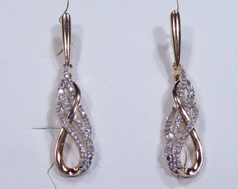 Vintage 10k rose gold earrings with 0.30ct single cut Diamond