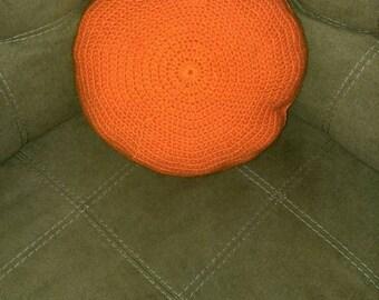 Round throw pillow.