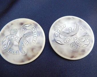 Large buttons with unusual motifs