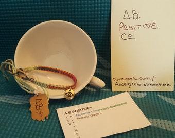 Behold charm bracelet