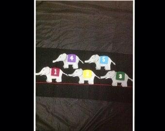 5 grey elephants balancing