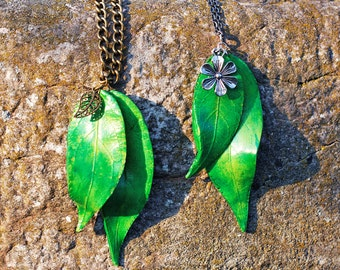 Green and yellow Leaf charm necklace in fimo and flower pendant.