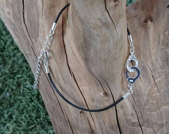 """Handcuffs"" silver bracelet 925, cord 1 mm leather and Silver 925 clasp."