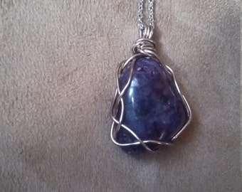 Wire wrapped purple stone