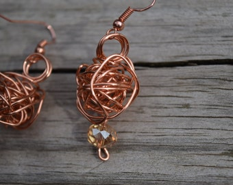 Handmade copper wire sphere earrings with glass beads