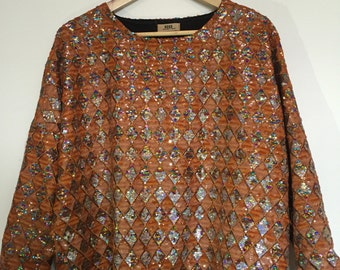 Fabulous sequinned long-sleeved top! Size 6-8