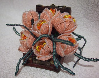 Flower handmade beads. A bouquet of flowers from beads.Beautiful flower.Beaded flowers/