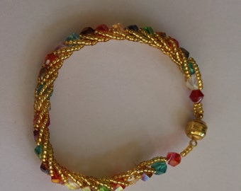 Multi-colored glass beaded gold, red, green, clear, purple bracelet with strong magnetic clasp