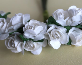 Decorative small flowers with roses. Bride, wedding favors, decorations.